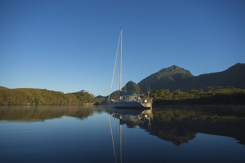 Helsal IV in Iola Bay with Mt Rugby in the background, Bathurst Narrows, South West Tasmania